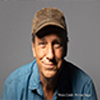 Mike Rowe in blue shirt and brown hat