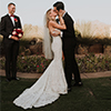 KRISTEN HENNEK Photographyn- Bride and groom first kiss outside at sunset thumbnail size