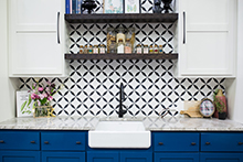 kitchen sink with blue cabinets