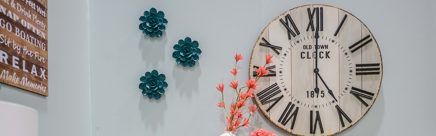 Clock on wall with wall decor