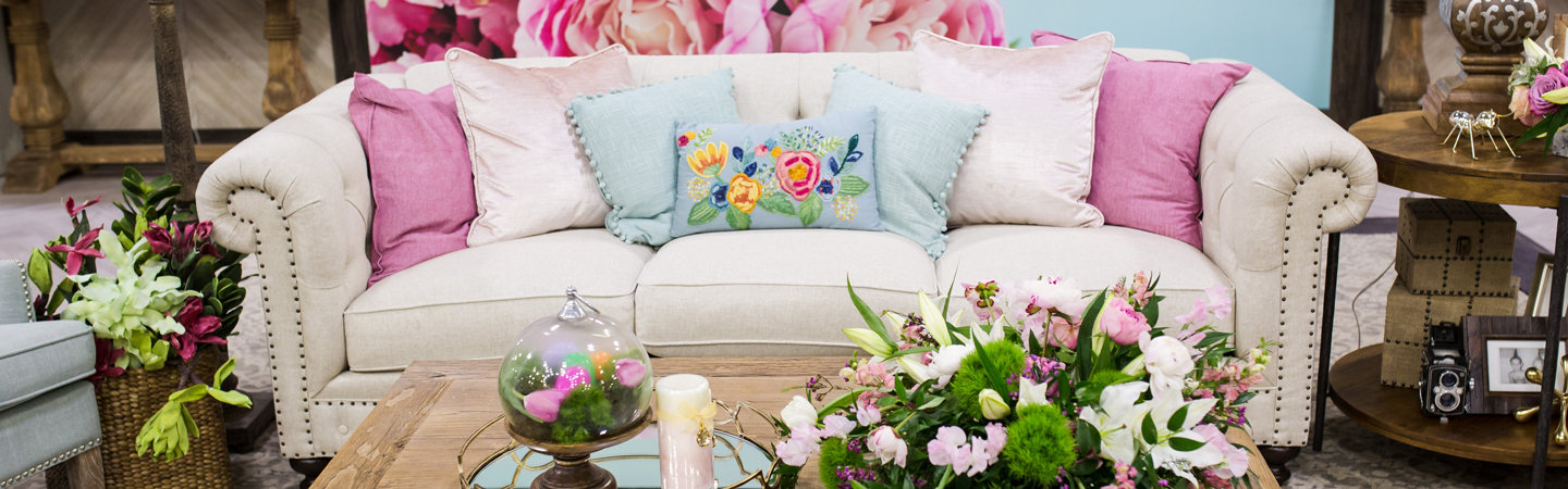 white sofa with pink flowers