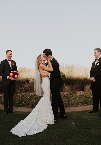Kristen Henneke Photography - Bride and Groom';s first kiss at sunset, outrdoors