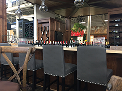 Wine bar with black high chairs
