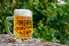 Beer mug with garden background