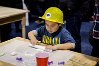 Little boy in yellow hard hat