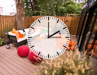 Backyard porch with clock displayed