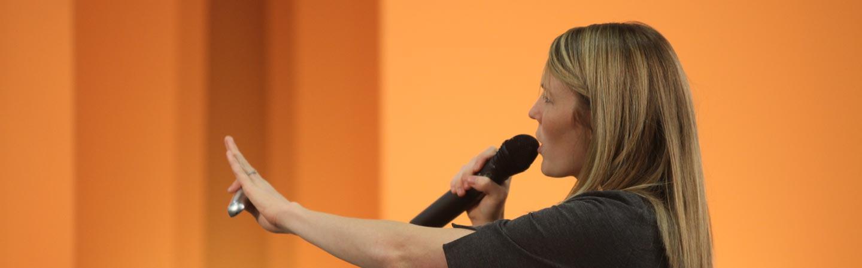 Speaker presenting on stage