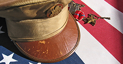 Military cap and American flag