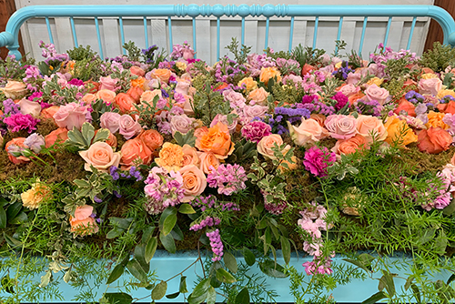An arrangement of abundant peach roses at the Indiana Flower + Patio Show
