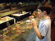 Child looking at train set