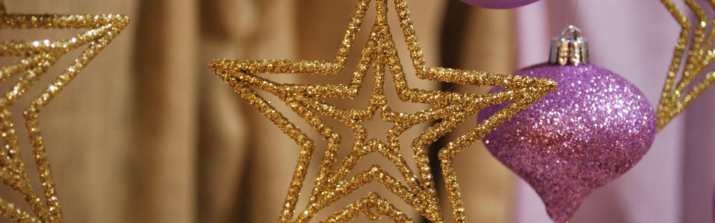 Holiday decorations gold star with lilac tree ornament