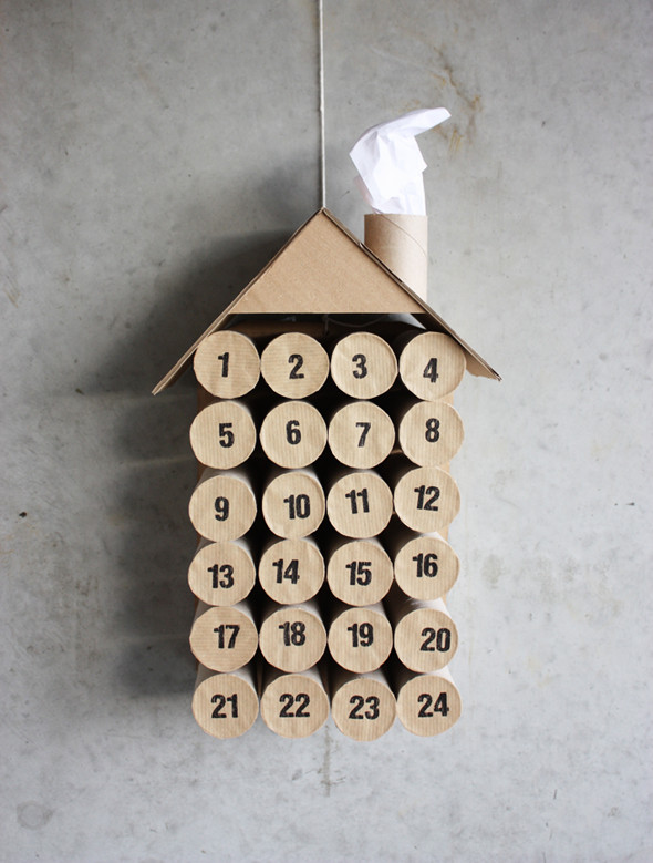 Advent calendar shaped like house, made of toilet paper rolls