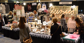 Holiday Boutique booth with shoppers